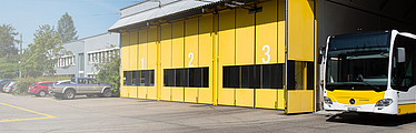 Folding doors at a bus depot