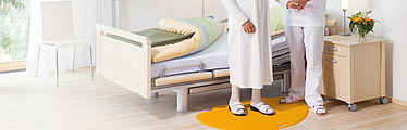 Safety pressure mat for the prevention of accidents in the healthcare sector